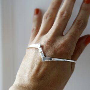 Sterling silver hidden heart bangle open on model