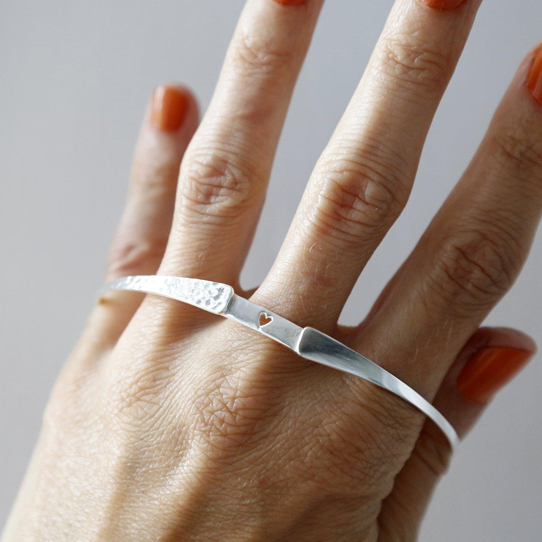 Sterling silver hidden heart bangle on model showing hidden heart