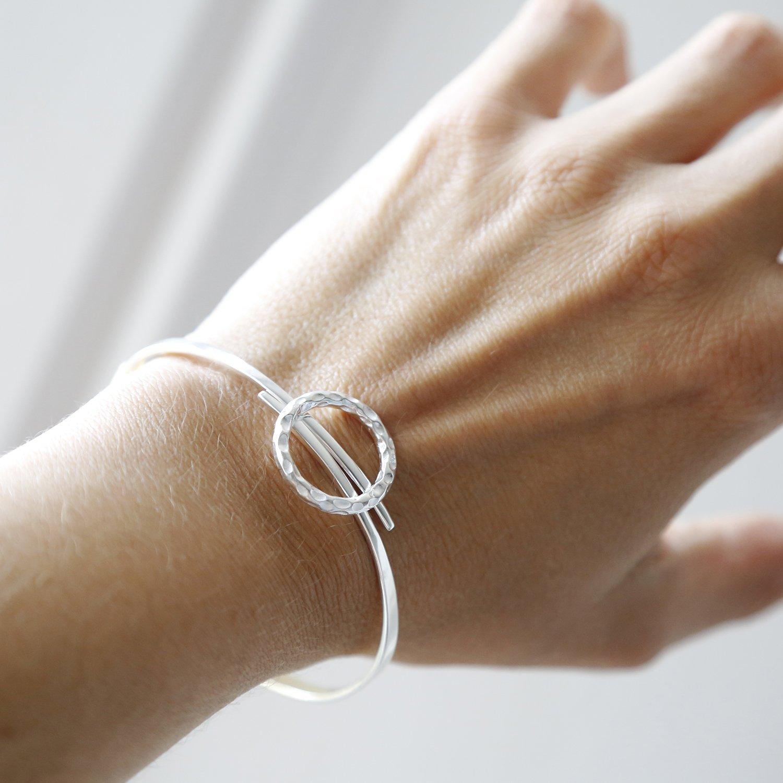 sterling silver joyful wreath bangle on wrist