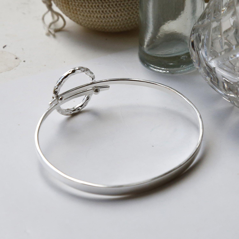 sterling silver joyful wreath bangle showing inside and back