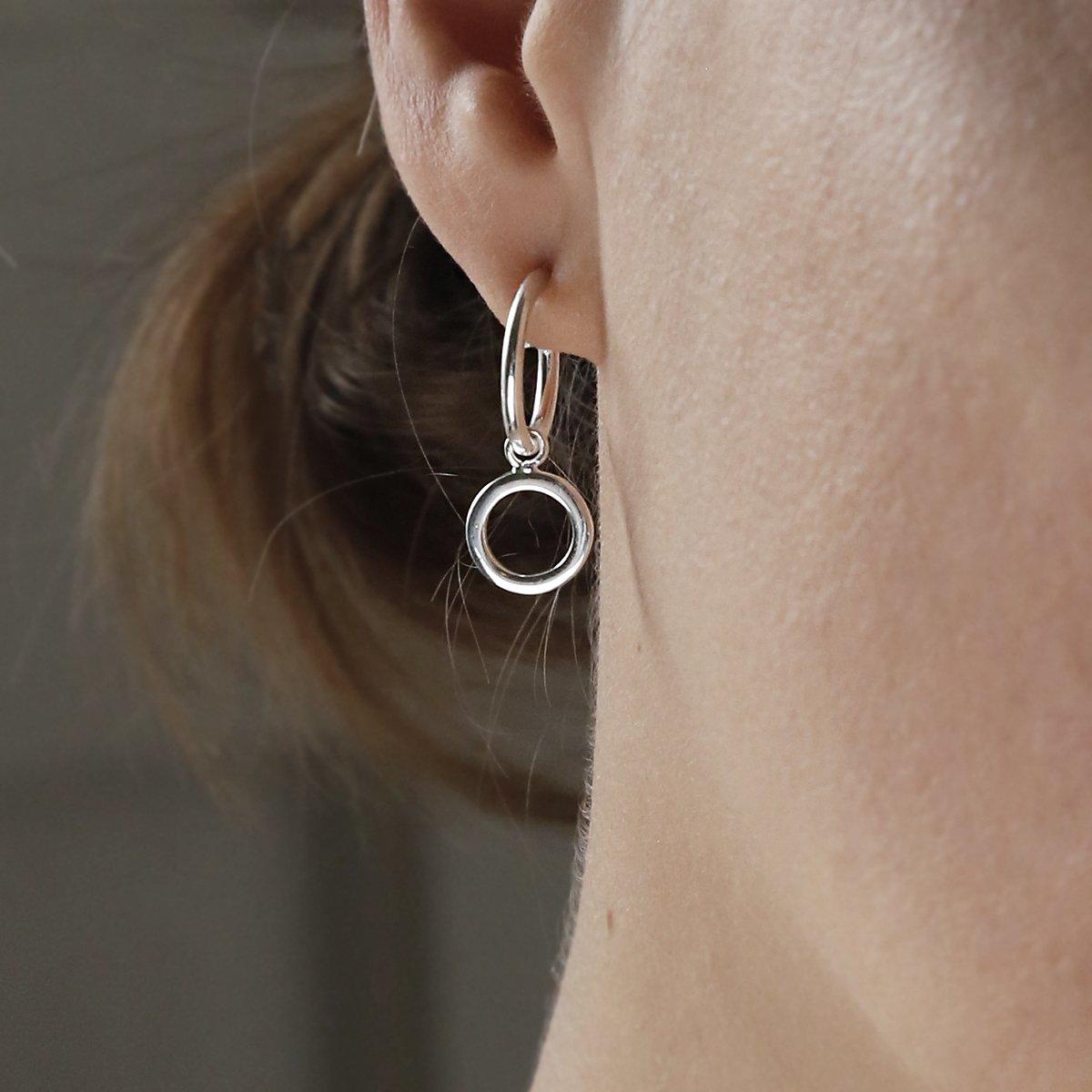 sterling silver circle hoop studs on model