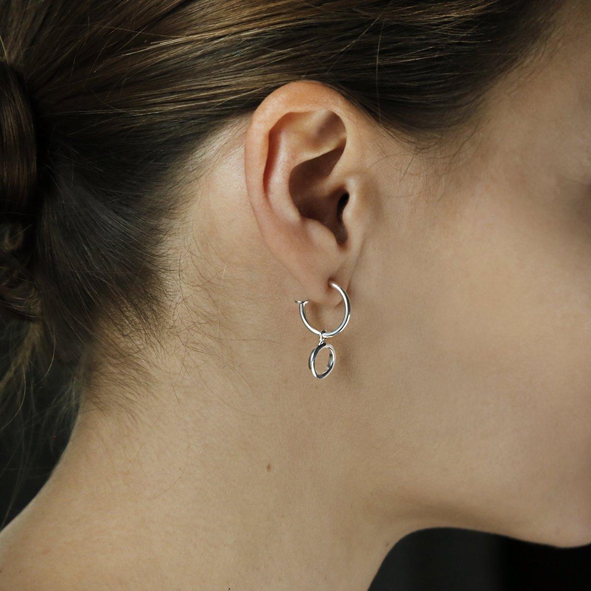 sterling silver circle hoop studs on profile of model
