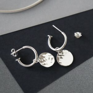 MZB94_Sterling Silver  Disc Stud Hoops on grey background catching light. showing butterfly off the hoop stud structure.