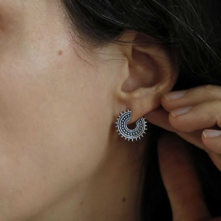 Oxidised sterling silver Marrakech studs on model with brunette hair.
