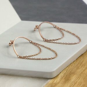 Rose Gold Half Circle Hoops with chain on multi coloured background tile