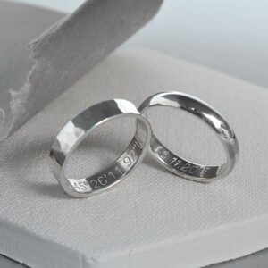 A pair of sterling silver friendship rings. One sterling silver hammered friendship ring and one polished friendship ring.