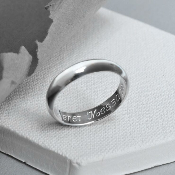 One polished sterling silver friendship ring engraved with personalised message.