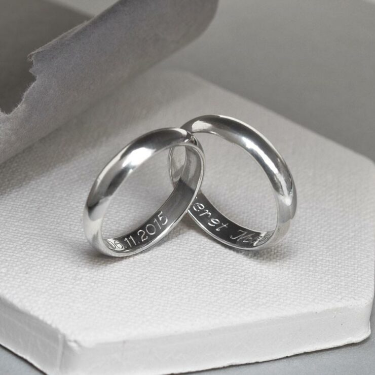 A pair of polished sterling silver friendship rings. Both rings engraved with personalised messages.