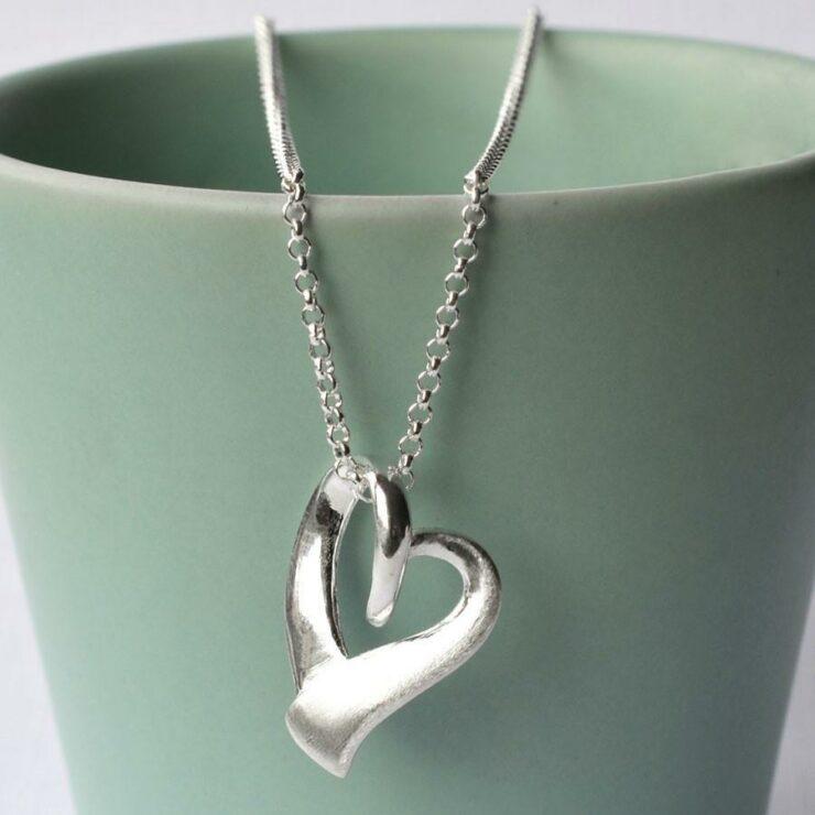 Silver Ribbon Heart Necklace by Martha Jackson