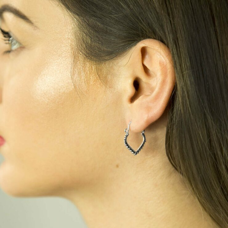 Oxidised and Silver Hoops with Circular detail on a Brunette Model