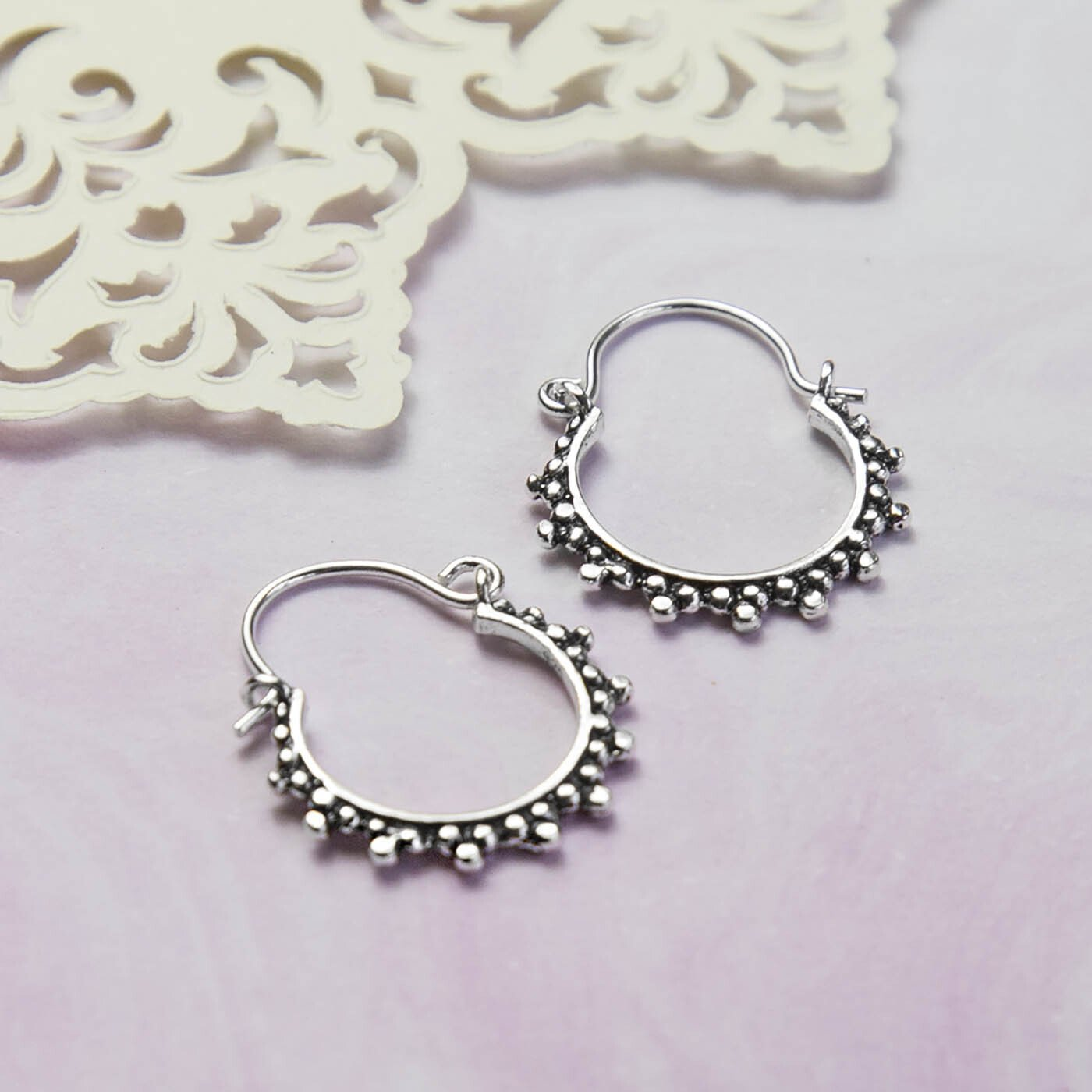 Silver and Oxidised Hoops with circular ball detail pattern on purple Watercolour background with Layered Cream Cut out Pattern paper