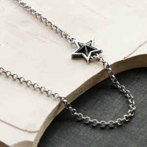 Oxidised Silver Chain Necklace with A Silver Oxidised Stars on a creamy, pastel Plaster Background