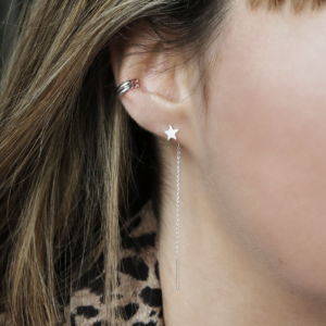 Sterling silver double row ear cuff and star ear threader on model wearing leopard print.