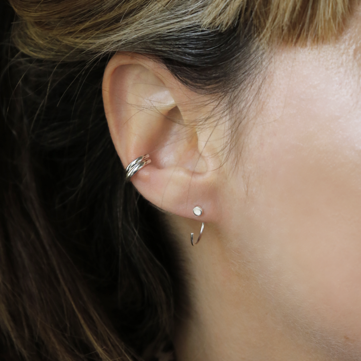 Sterling silver double row ear cuff and nail hoop threader on model.