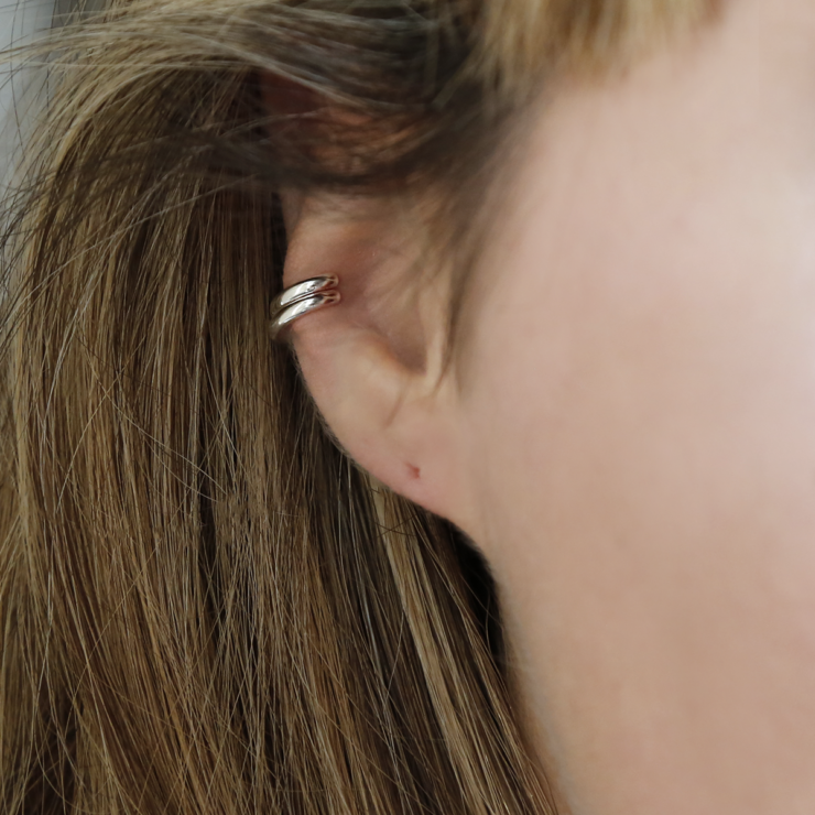 Sterling silver double row ear cuff on model with blonde highlights.