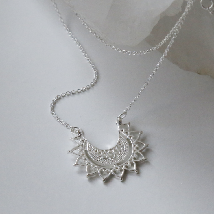 Sterling silver marrakech affair necklace on white background with crystal.