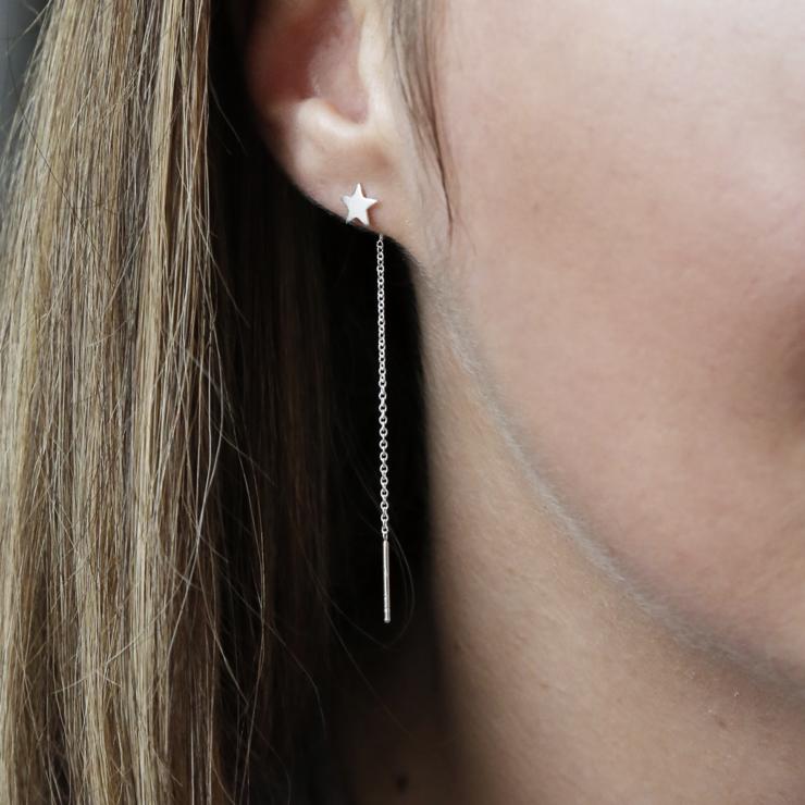 Sterling silver star ear threader on model.