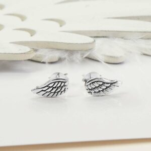 Small Silver Angel Wing Studs with white feather and wooden feather background