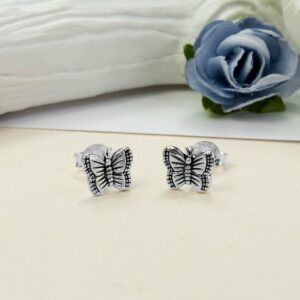 Small Silver Butterfly studs with Blue and white roses in the background