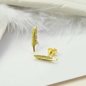 Small Gold feather  with White ceramic feather and white feather as backgound