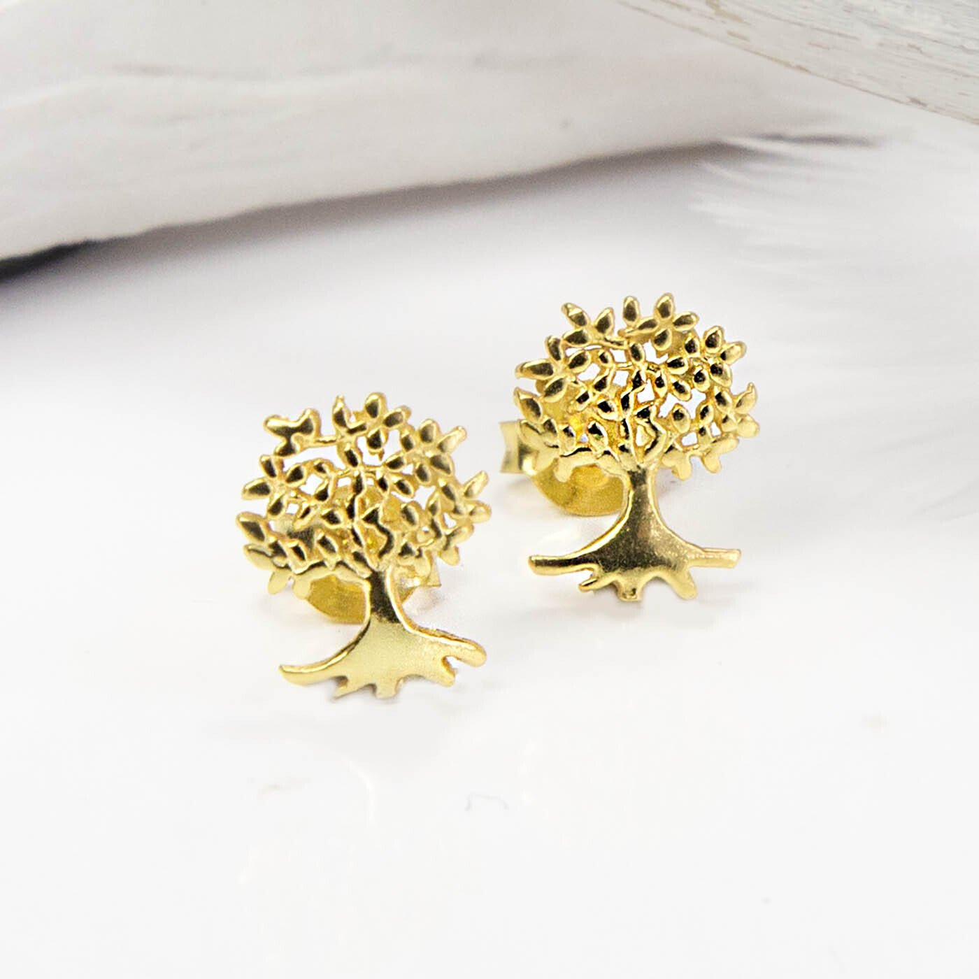 Small Gold Tree studs with white feathers and background