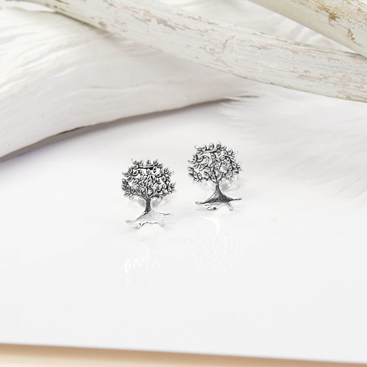 Silver Tree studs with white feathers and background