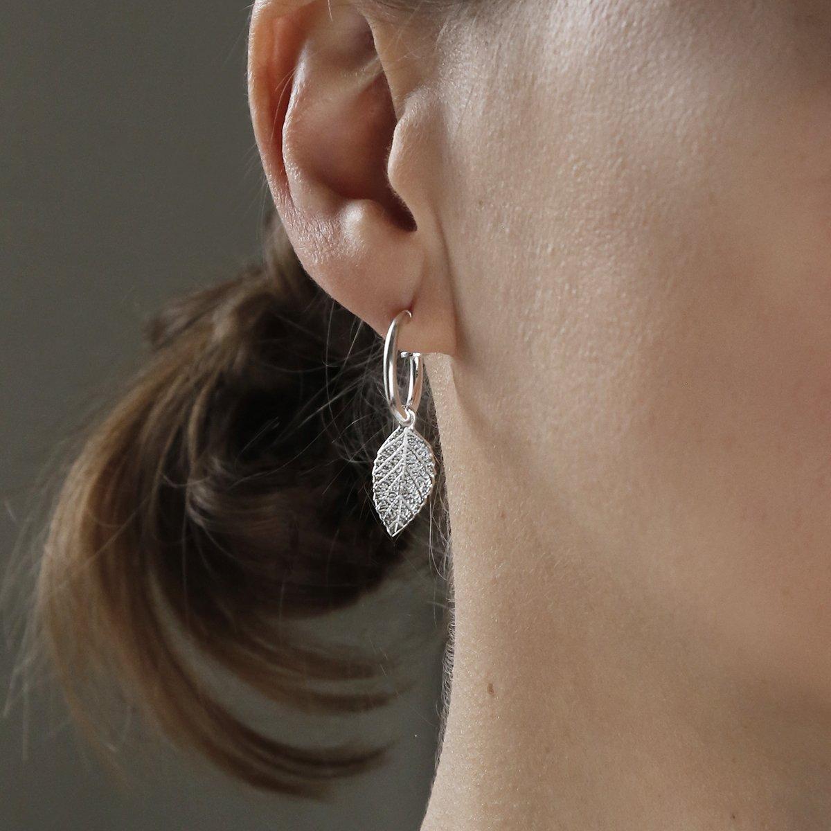 sterling silver leaf hoops studs on model