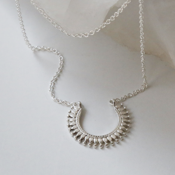 Sterling silver Marrakech horseshoe necklace shown on white background.