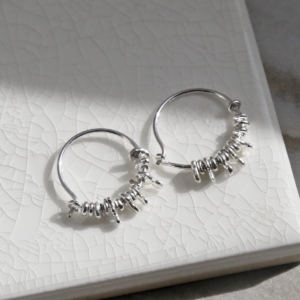ml918 sterling silver gypsy hoops closed on white background.
