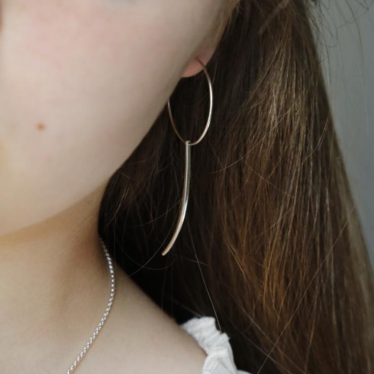 Silver Hoop Earrings with Claw on brunette model