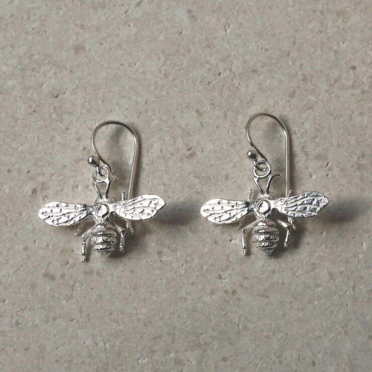 sterling silver dangly bee earrings laid out