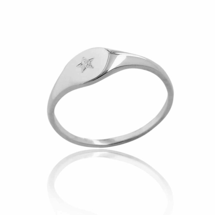 Single engraved with star small silver signet ring blank background