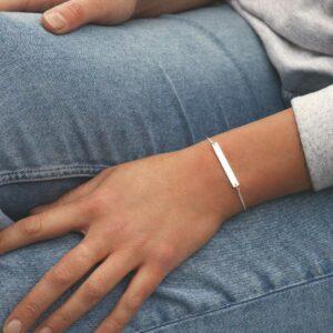 model wearing plain sterling silver adjustable identity bracelet