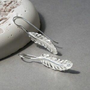 Sterling Silver Feather Drop Earrings Sat on Slate