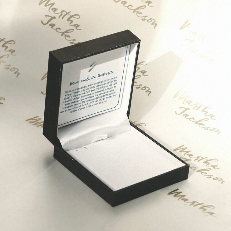 Meteorite Box on a White background with the Martha Jackson Logo