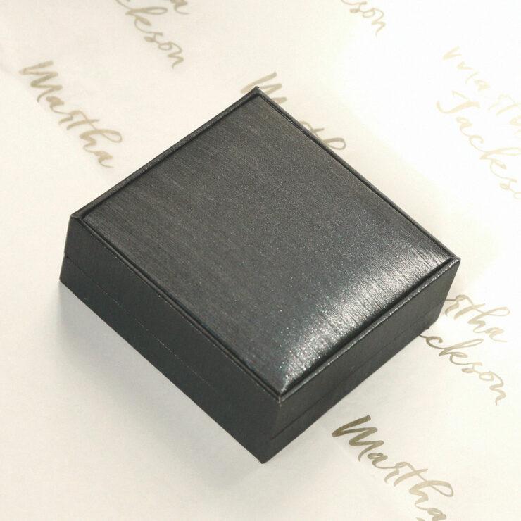 Luxury Box on a White background with the Martha Jackson Logo