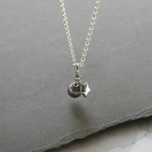 Meteorite Sphere and silver star hanging from a belcher
