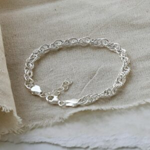 Sterling Silver Twisted Rope Bracelet on a linen material