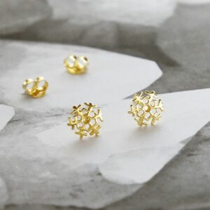 Sterling Silver and Gold Tiny Snowflake Stud Earring Pack on marble