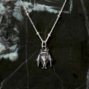 Sterling Silver Oxidised Origami Owl Necklace on satellite chain on black marble background.