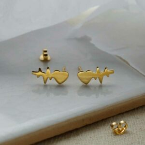 Gold Plated Sterling Silver Heart Wave Studs sat on marble with shadows being cast