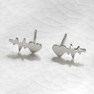 Sterling Silver Heart Wave Studs sat on marble with a shadow being cast.