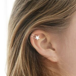 Sterling Silver Star Ear Cuffs round the top of a girls ear