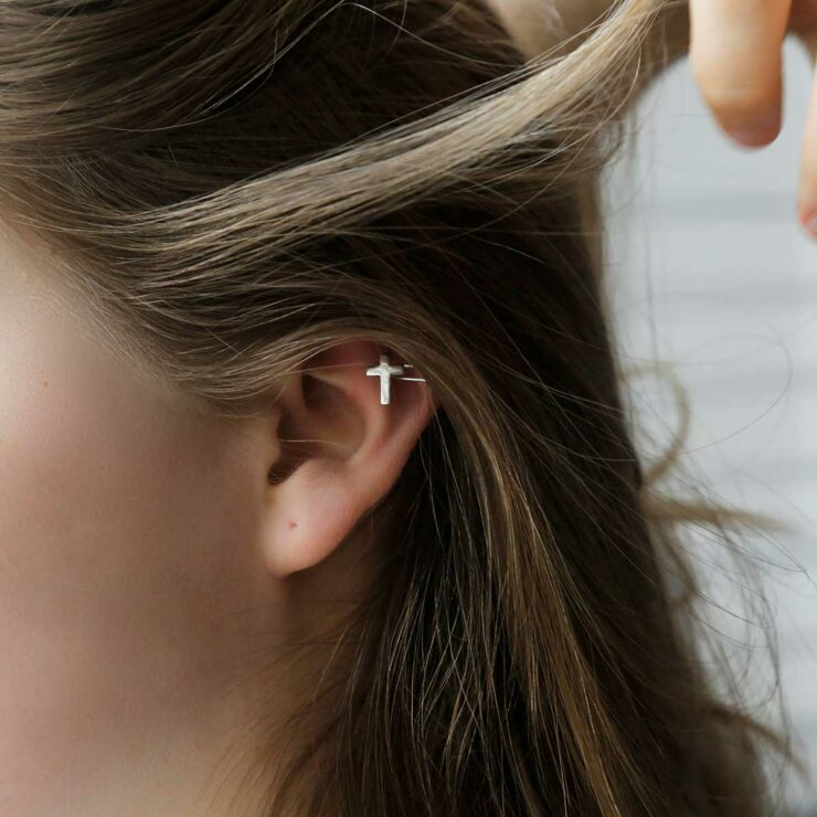 Sterling silver ear cuff round the top of a girls ear