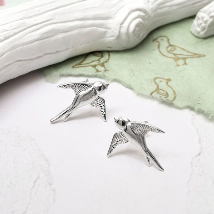 Swallow Studs with green handmade paper on bird detail and white branch props
